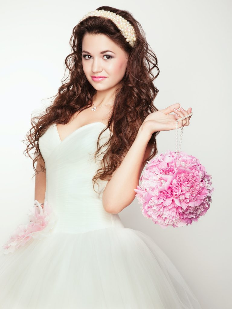 Portrait of beautiful bride. Wedding dress.